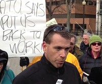 Transit union president Ken Wilson talks to the press