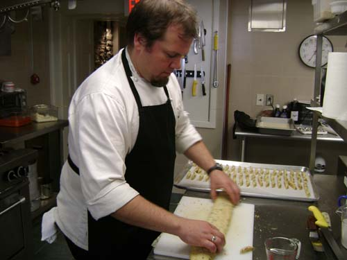 Chef Steve rolls out orange, pecan white-chocolate biscotti for tea.
